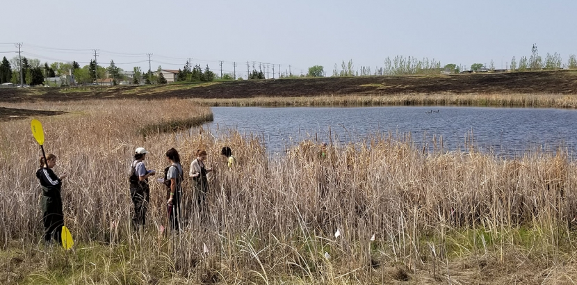 STUDENTS PREPARE FOR SAMPLES AT THE SMARTPARK POND TUESDAY MORNING.
